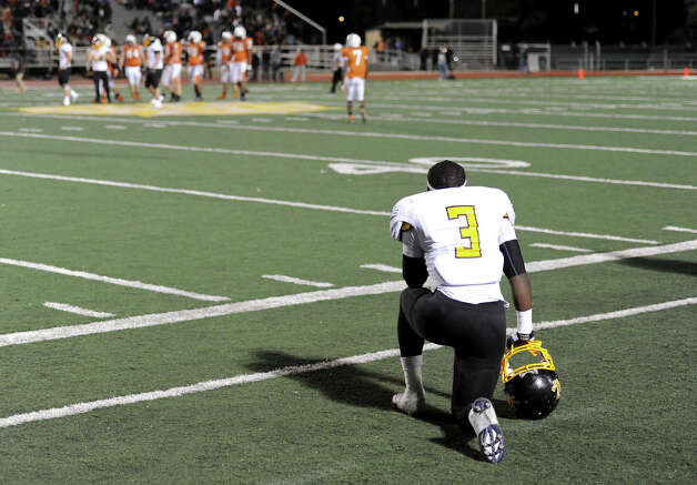 East Central's Javion Polk (3) can only watch as the Hornets are shutout by the Madison Mavericks during a Class 5A Division I second round playoff game at Comalander Stadium in San Antonio, Friday, November 23, 2012.