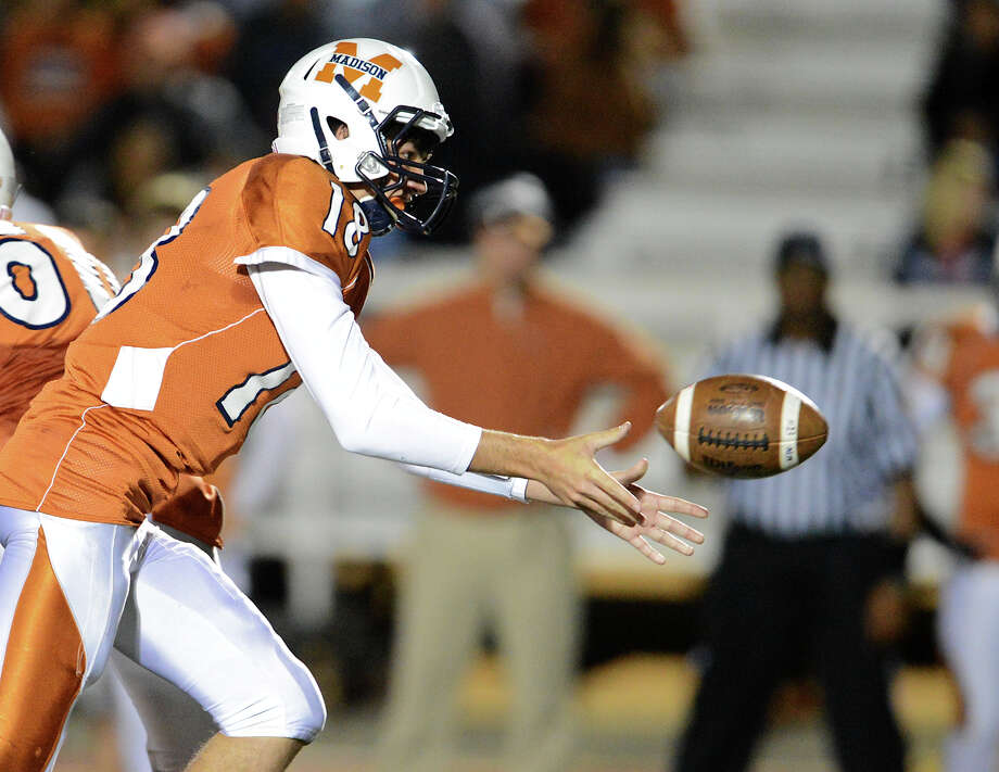 Madison quarterback Tyler Mangold pitches the ball back to a running back during a Class 5A Division I second round playoff game between the Madison Mavericks and the East Central Hornets at Comalander Stadium in San Antonio, Friday, November 23, 2012.