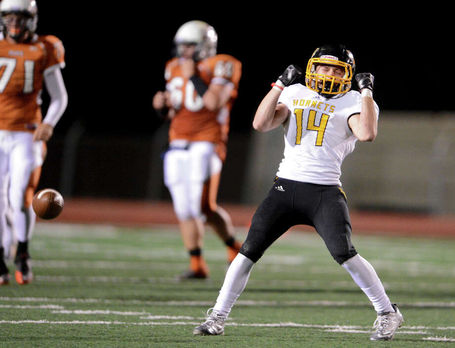 East Central's Russell Brown (14) reacts after dropping an interception during a Class 5A Division I second round playoff game between the Madison Mavericks and the East Central Hornets at Comalander Stadium in San Antonio, Friday, November 23, 2012.