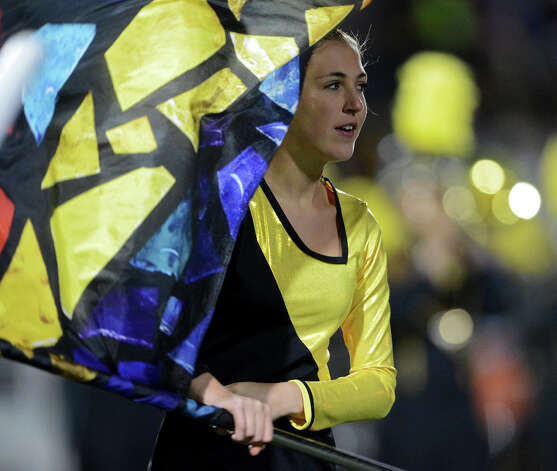 A member of the East Central flag squad preforms at halftime of a Class 5A Division I second round playoff game between the Madison Mavericks and the East Central Hornets at Comalander Stadium in San Antonio, Friday, November 23, 2012.