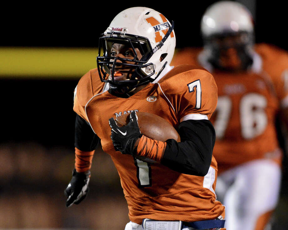 Madison's Marquis Warford (7) races towards the endzone during a Class 5A Division I second round playoff game between the Madison Mavericks and the East Central Hornets at Comalander Stadium in San Antonio, Friday, November 23, 2012. John Albright / Special to the Express-News. Photo: JOHN ALBRIGHT, Express-News / San Antonio Express-News