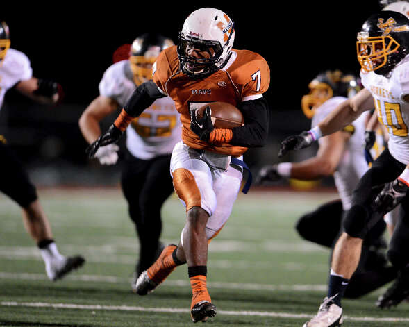 Madison's Marquis Warford (7) runs into the East Central secondary during a Class 5A Division I second round playoff game at Comalander Stadium in San Antonio, Friday, November 23, 2012.