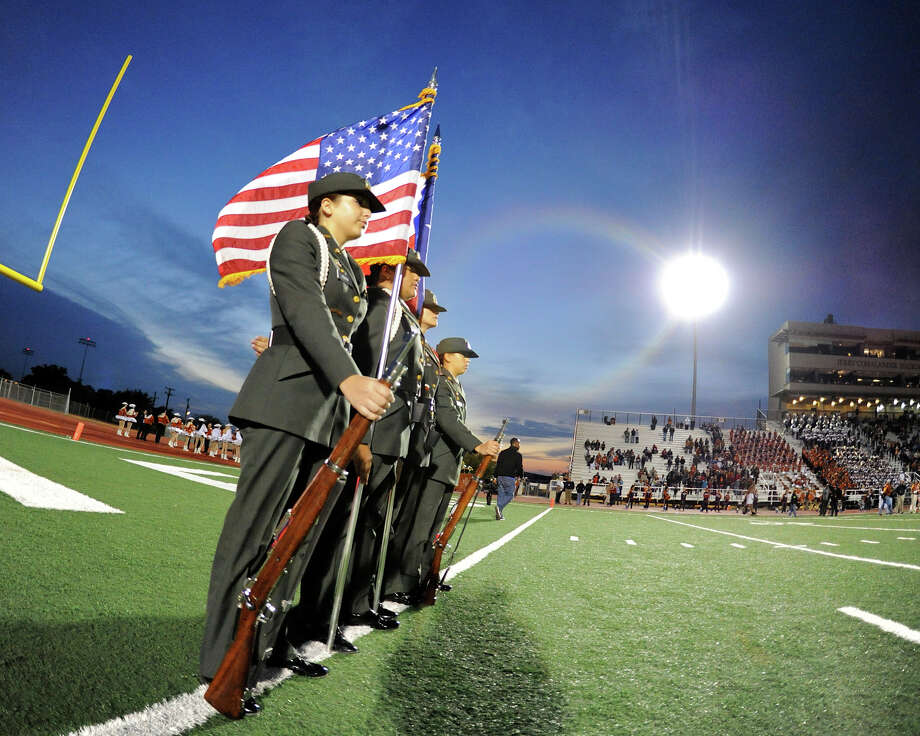 Madison's JR-ROTC waits to present the colors before a Class 5A Division I second round playoff game at Comalander Stadium in San Antonio, Friday, November 23, 2012. John Albright / Special to the Express-News. Photo: JOHN ALBRIGHT, Express-News / San Antonio Express-News