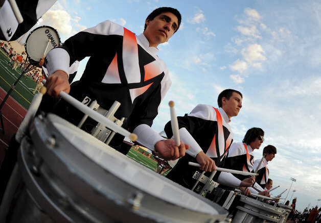 The Madison drum line plays before a Class 5A Division I second round playoff game at Comalander Stadium in San Antonio, Friday, November 23, 2012.