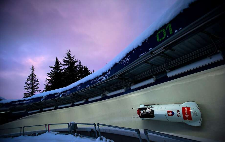 Milan Jagnesak and Vladimir Simik guide the Slovakia 1 bobsled down the track during the men's two-man bobsled World Cup event in Whistler, British Columbia, on Friday, Nov. 23, 2012. Photo: Darryl Dyck, Associated Press
