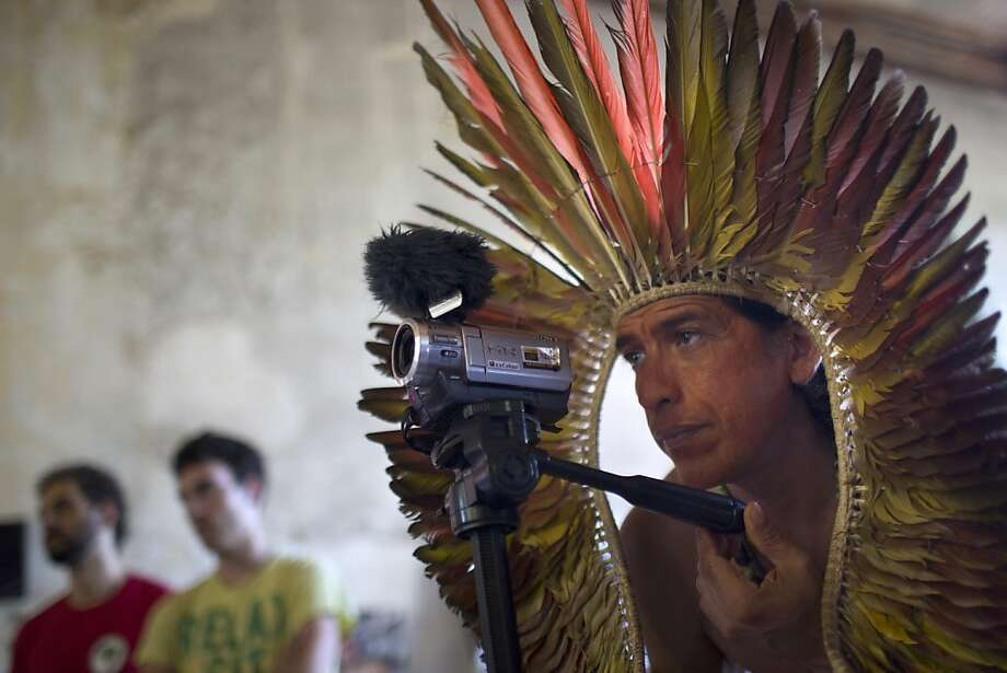 A indigenous man films a press conference in the Indian Museum next to the Maracana stadium in Rio de Janeiro, Brazil, Friday, Nov. 23, 2012. Indigenous leaders reiterated their determination to fight the destruction of the Indian Museum, set to be demolished as part of the renovation of the Maracana stadium that will host next year's Confederations Cup and the 2014 World Cup soccer tournament. Photo: Felipe Dana, Associated Press