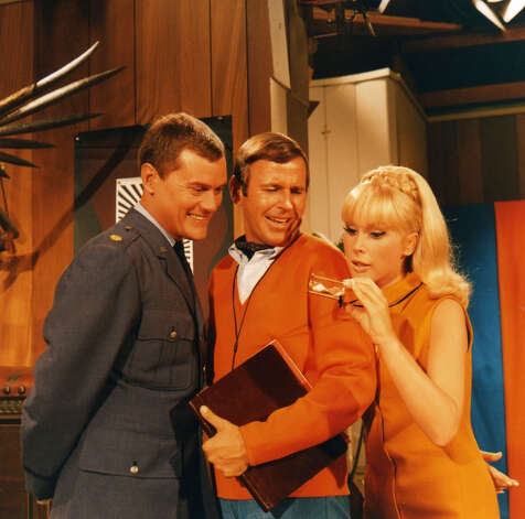 "Before ""Dallas,"" there was ""I Dream of Jeannie"" in the 1960s. Shown are stars Hagman, Paul Lynde and Barbara Eden. Hagman played an astronaut whose genie, Eden, repeatedly left her bottle and got into trouble."