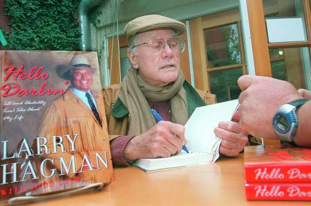 Hagman signs a copy of his book at a bookstore in Ojai,  Calif.,  in 2001.
