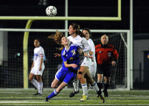 Newtown #2 Dale Shearin, left, and Glastonbury's #8 Madeline Gray intercept the ball, Class LL girls soccer championship action in West Haven, Conn. on Friday November 23, 2012. Photo: Christian Abraham