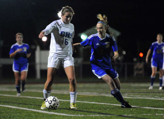 Newtown #3 Sarah Lynch, right, and Glastonbury's #8 Madeline Gray chase down the ball, during Class LL girls soccer championship action in West Haven, Conn. on Friday November 23, 2012. Photo: Christian Abraham