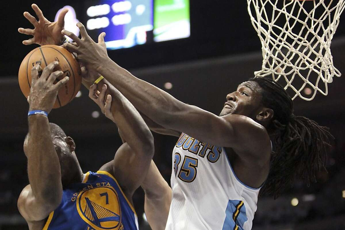 Golden State Warriors forward Carl Landry (7) grabs a rebound from Denver Nuggets forward Kenneth Faried (35) during the fourth quarter of an NBA basketball game Friday, Nov. 23, 2012, in Denver. The Nuggets won 102-91. (AP Photo/Barry Gutierrez)