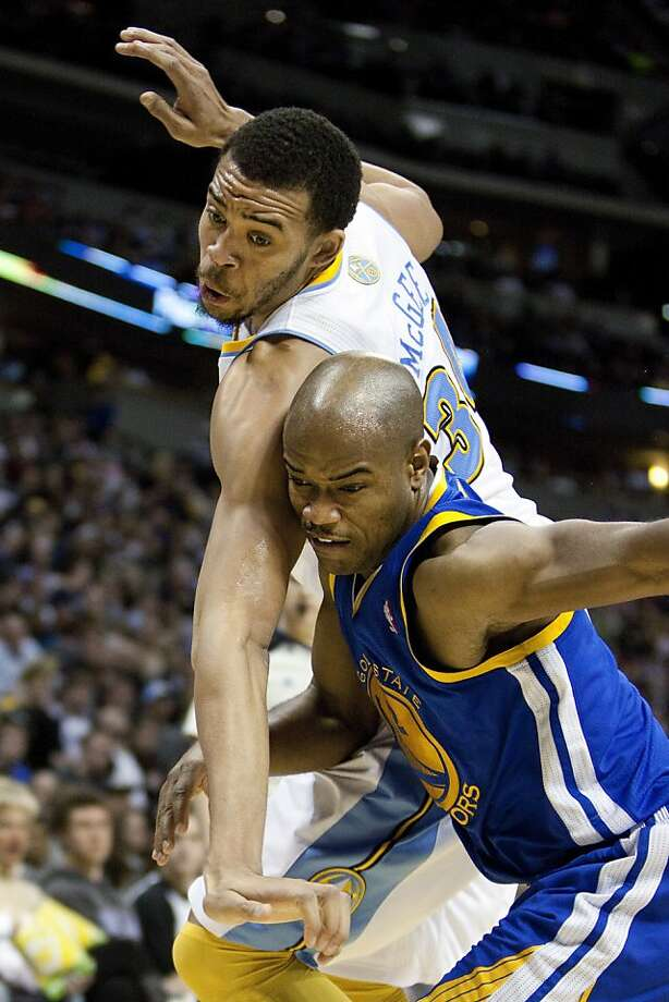 Denver Nuggets center JaVale McGee, top, and Golden State Warriors guard Jarrett Jack, bottom, vie for position during the fourth quarter of an NBA basketball game Friday, Nov. 23, 2012, in Denver. The Nuggets won 102-91.(AP Photo/Barry Gutierrez) Photo: Barry Gutierrez, Associated Press
