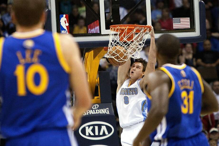 Denver Nuggets small forward Danilo Gallinari (8) dunks on a a fast break against the Golden State Warriors during the first quarter of an NBA basketball game Friday, Nov. 23, 2012, in Denver. (AP Photo/Barry Gutierrez) Photo: Barry Gutierrez, Associated Press