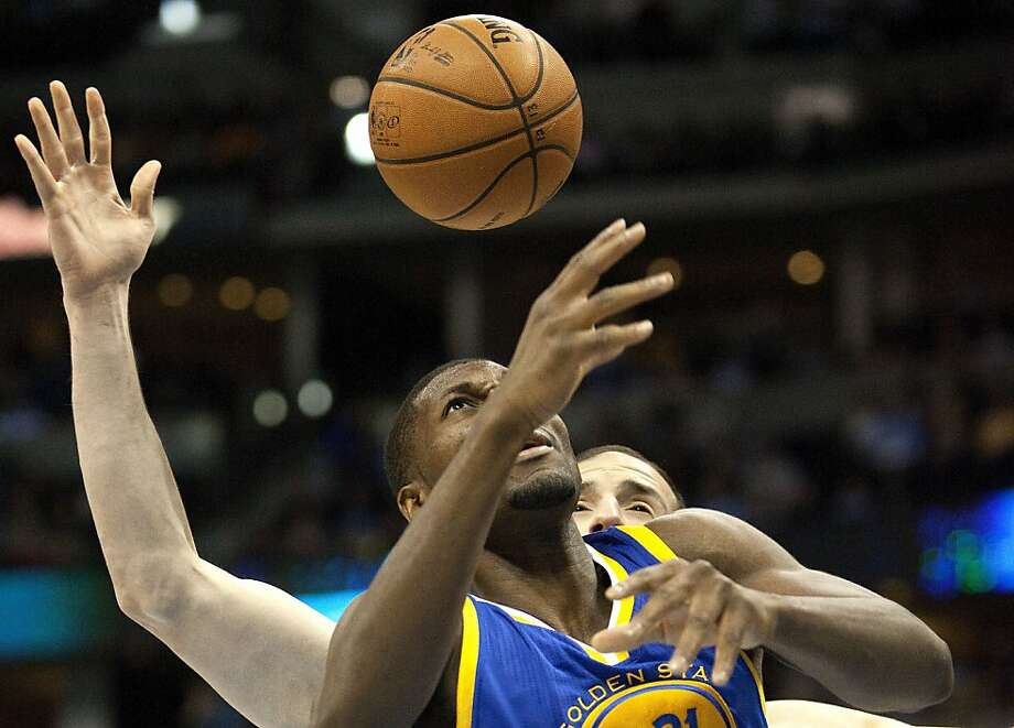 Golden State Warriors center Festus Ezeli, front, leaps for an offensive rebound in front of Denver Nuggets center Kosta Koufos during the first quarter of an NBA basketball game Friday, Nov. 23, 2012, in Denver. (AP Photo/Barry Gutierrez) Photo: Barry Gutierrez, Associated Press