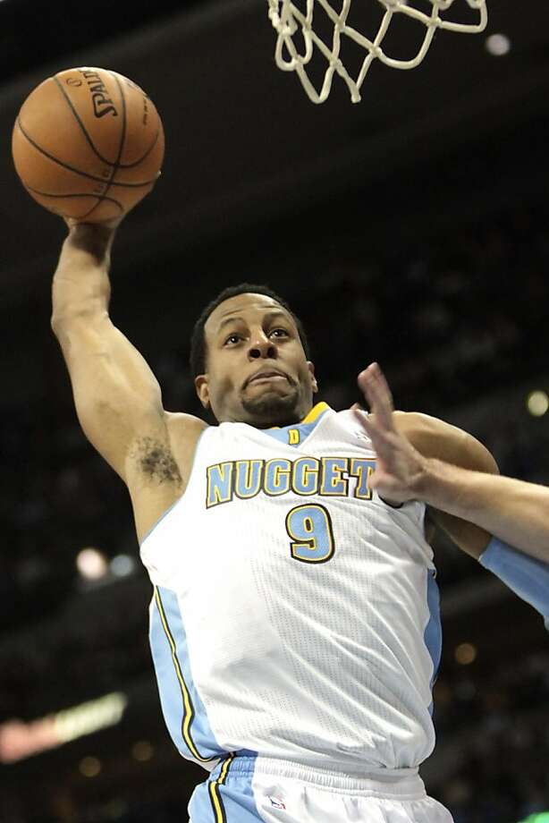 Denver Nuggets guard Andre Iguodala heads to the basket against the Golden State Warriors during the fourth quarter of an NBA basketball game Friday, Nov. 23, 2012, in Denver. The Nuggets won 102-91. (AP Photo/Barry Gutierrez) Photo: Barry Gutierrez, Associated Press