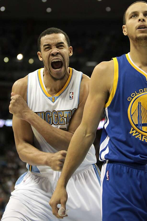 Denver Nuggets center JaVale McGee (34) reacts after dunk, next to Golden State Warriors guard Stephen Curry, right, during the fourth quarter of an NBA basketball game Friday, Nov. 23, 2012 in Denver. The Nuggets won 102-91. (AP Photo/Barry Gutierrez) Photo: Barry Gutierrez, Associated Press