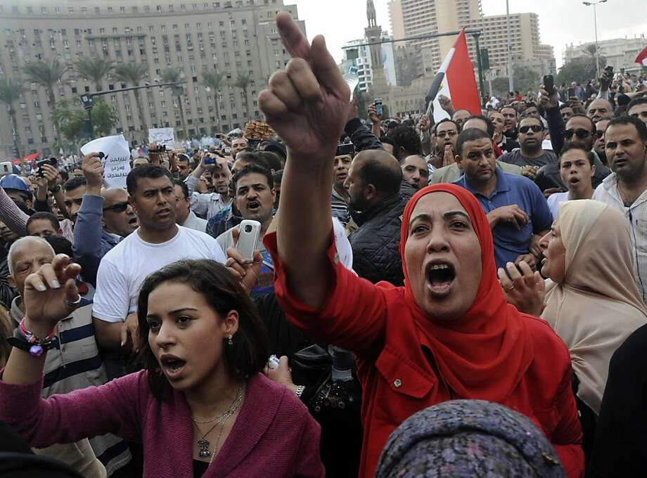 Egyptian protesters opposed to president Mohammed Morsi chant slogans in Tahrir Square in Cairo, Egypt, Friday, Nov. 23, 2012. Opponents and supporters of Mohammed Morsi clashed across Egypt on Friday, the day after the president granted himself sweeping new powers that critics fear can allow him to be a virtual dictator.(AP Photo/Mohammed Asad) Photo: Mohammed Asad, Associated Press