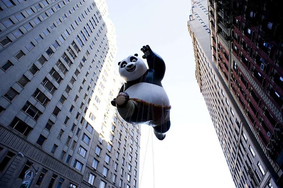 The Kung Fu Panda balloon floats in the Macy's Thanksgiving Day Parade in New York in New York, Thursday, Nov. 22, 2012. (AP Photo/Charles Sykes) Photo: Charles Sykes, Associated Press
