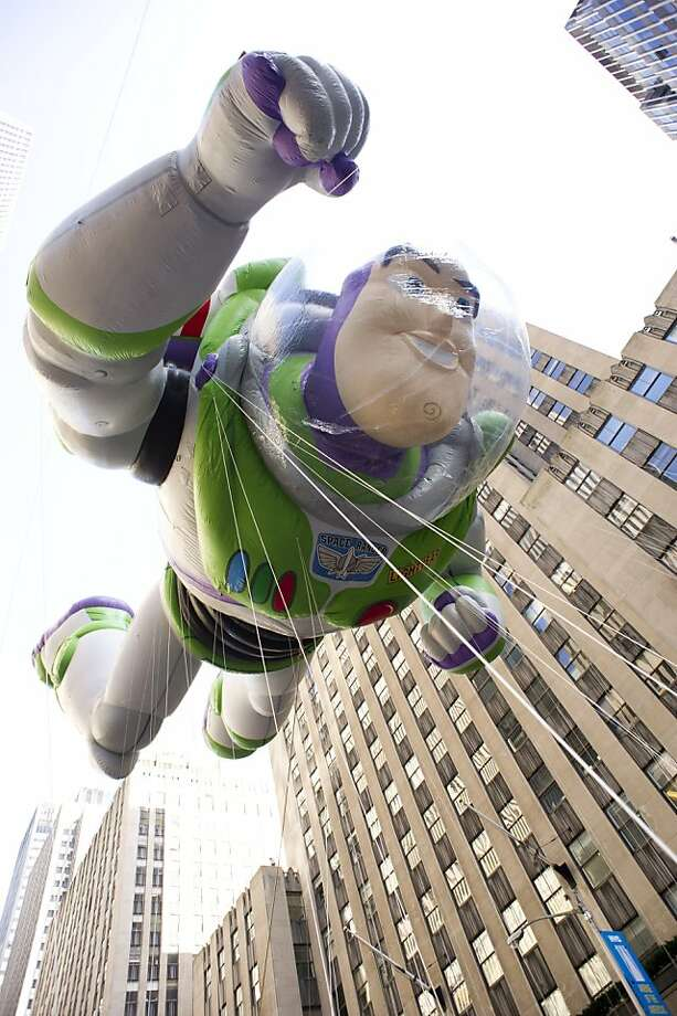 The Buzz Lightyear balloon floats in the Macy's Thanksgiving Day Parade in New York in New York, Thursday, Nov. 22, 2012. (AP Photo/Charles Sykes) Photo: Charles Sykes, Associated Press