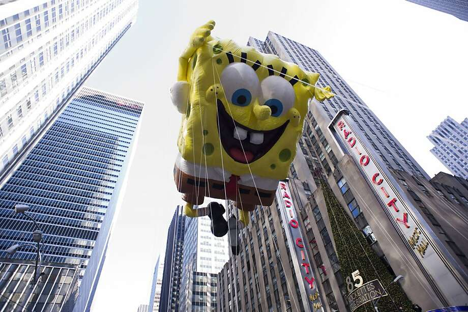 The Spongebob Squarepants balloon floats in the Macy's Thanksgiving Day Parade in New York in New York, Thursday, Nov. 22, 2012. (AP Photo/Charles Sykes) Photo: Charles Sykes, Associated Press