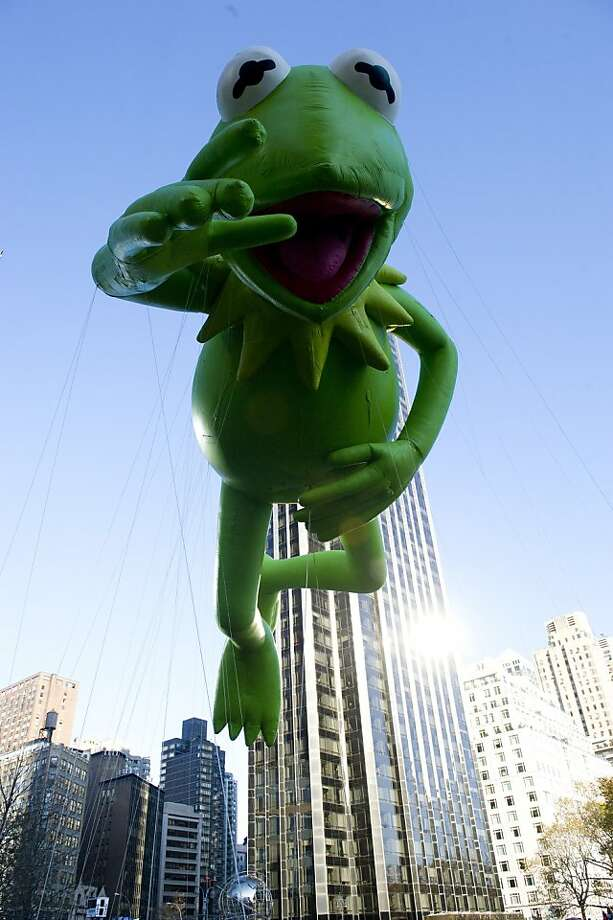 The Kermit the Frog balloon floats in the Macy's Thanksgiving Day Parade in New York in New York, Thursday, Nov. 22, 2012. (AP Photo/Charles Sykes) Photo: Charles Sykes, Associated Press