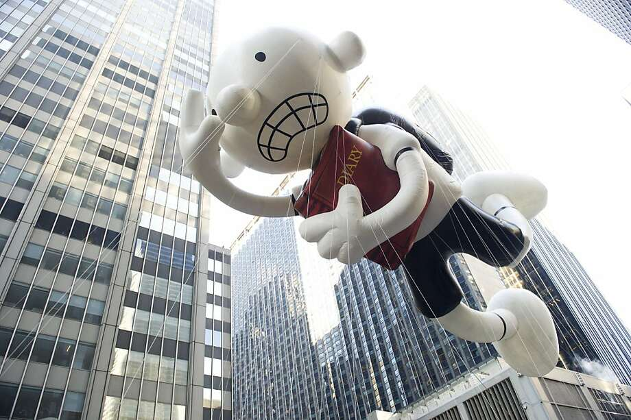 The Diary of a Wimpy Kid balloon floats in the Macy's Thanksgiving Day Parade in New York in New York, Thursday, Nov. 22, 2012. (AP Photo/Charles Sykes) Photo: Charles Sykes, Associated Press