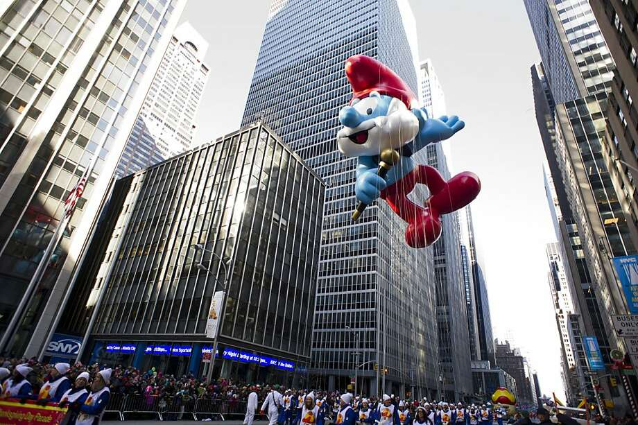 The Papa Smurf  balloon floats in the Macy's Thanksgiving Day Parade in New York in New York, Thursday, Nov. 22, 2012. (AP Photo/Charles Sykes) Photo: Charles Sykes, Associated Press