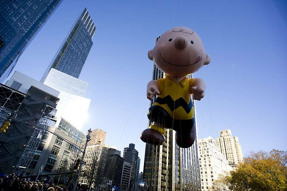 The Charlie Brown balloon floats in the Macy's Thanksgiving Day Parade in New York in New York, Thursday, Nov. 22, 2012. (AP Photo/Charles Sykes) Photo: Charles Sykes, Associated Press