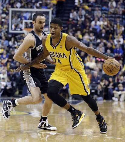 Indiana Pacers' Paul George works against San Antonio Spurs' Manu Ginobili during the first half of an NBA basketball game Friday, Nov. 23, 2012, in Indianapolis.  (Darron Cummings / Associated Press)