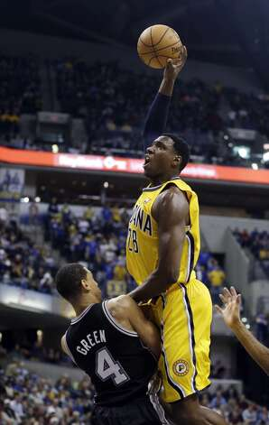 Indiana Pacers' Ian Mahinmi dunks over San Antonio Spurs' Danny Green during the first half of an NBA basketball game Friday, Nov. 23, 2012, in Indianapolis.  (Darron Cummings / Associated Press)