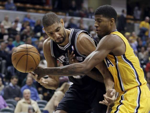 San Antonio Spurs' Tim Duncan, left, works against Indiana Pacers' Paul George during the second half of an NBA basketball game Friday, Nov. 23, 2012, in Indianapolis. The Spurs won 104-97.  (Darron Cummings / Associated Press)