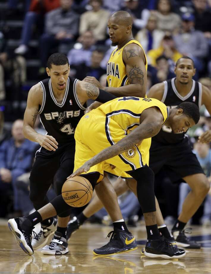 Indiana Pacers' Paul George, right, is stripped of the basketball by San Antonio Spurs' Danny Green (4) during the second half of an NBA basketball game Friday, Nov. 23, 2012, in Indianapolis. The Spurs won 104-97. (Darron Cummings / Associated Press)
