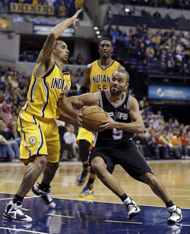 San Antonio Spurs' Tony Parker drives to the basket against Indiana Pacers' George Hill during the second half of an NBA basketball game Friday, Nov. 23, 2012, in Indianapolis. The Spurs won 104-97.  (Darron Cummings / Associated Press)