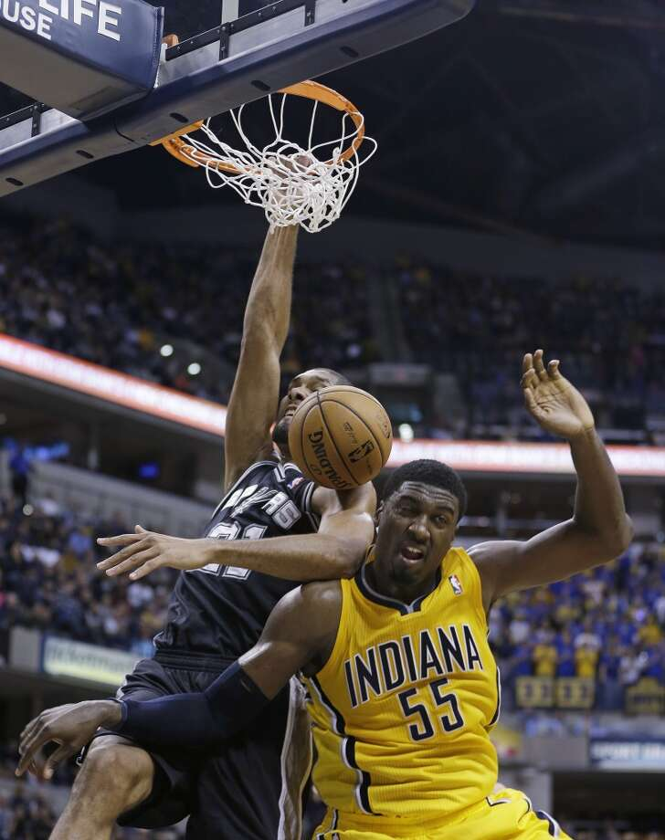 San Antonio Spurs' Tim Duncan dunks against Indiana Pacers' Roy Hibbert during the second half of an NBA basketball game Friday, Nov. 23, 2012, in Indianapolis. The Spurs won 104-97. (Darron Cummings / Associated Press)