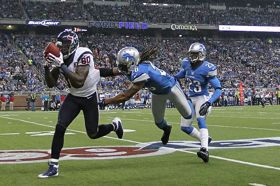 Texans wide receiver Andre Johnson (80) makes a catch on a long pass against Lions free safety Louis Delmas (26) and  cornerback Chris Houston (23) during the second quarter. Photo: Karen Warren, Houston Chronicle / © 2012  Houston Chronicle