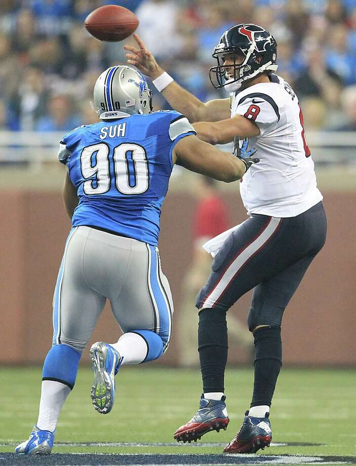 Texans quarterback Matt Schaub (8) tries to get the ball away before being hit by Lions defensive tackle Ndamukong Suh (90). Photo: Karen Warren, Houston Chronicle / © 2012  Houston Chronicle