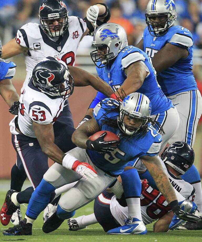 Lions running back Mikel Leshoure (25) gains a few yards against Texans inside linebacker Bradie James (53) during the third quarter. Photo: Karen Warren, Houston Chronicle / © 2012  Houston Chronicle
