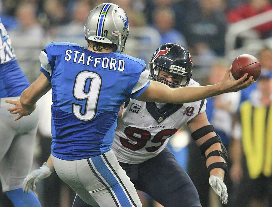 Lions quarterback Matthew Stafford (9) tries to get a pass off as he is hit by Texans defensive end J.J. Watt (99) during the fourth quarter. Photo: Karen Warren, Houston Chronicle / © 2012  Houston Chronicle