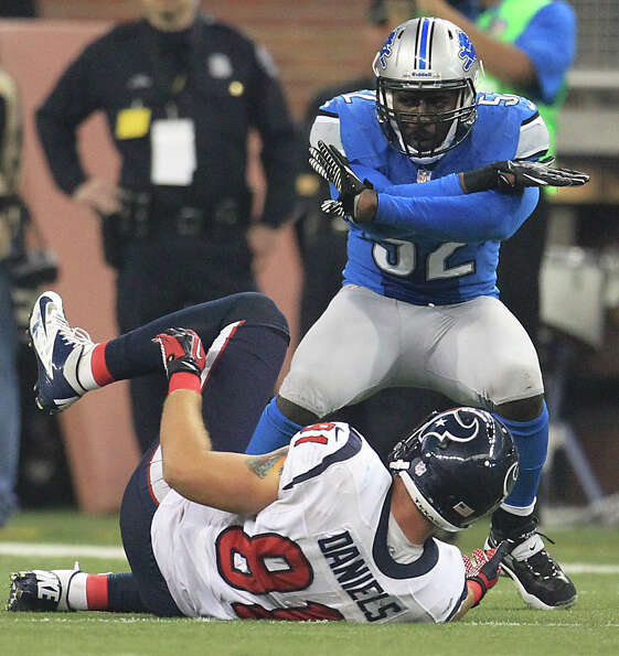 Lions outside linebacker Justin Durant (52) signals that Texans tight end Owen Daniels (81) did not