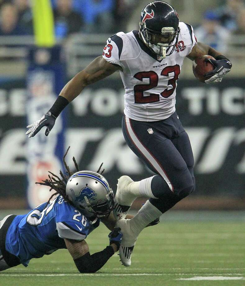 Texans running back Arian Foster (23) tries to avoid a tackle by Lions free safety Louis Delmas (26) during the third quarter. Photo: Karen Warren, Houston Chronicle / © 2012  Houston Chronicle