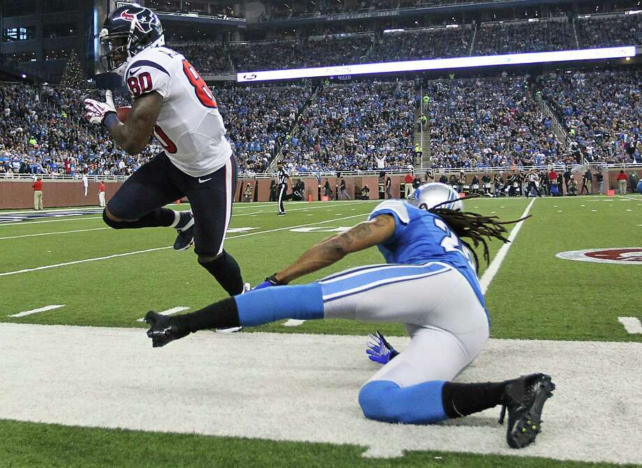 Texans wide receiver Andre Johnson (80) makes a catch on a long pass against Lions free safety Louis Delmas (26) during the second quarter. Photo: Karen Warren, Houston Chronicle / © 2012  Houston Chronicle