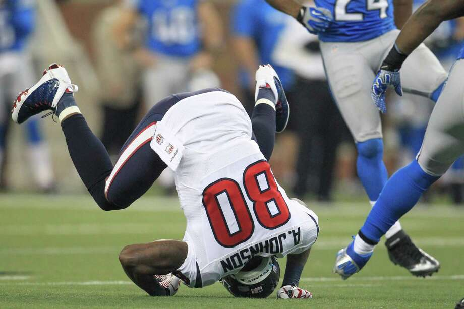 Texans wide receiver Andre Johnson (80) is upended on a pass play during the second quarter. Photo: Karen Warren, Houston Chronicle / © 2012  Houston Chronicle