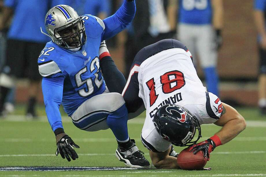 Texans tight end Owen Daniels (81) tumbles to the ground after catching a pass against Lions outside linebacker Justin Durant (52) during the first quarter. Photo: Karen Warren, Houston Chronicle / © 2012  Houston Chronicle