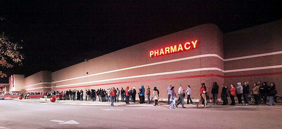Customers line up outside a Target store for Black Friday deals Thursday night, Nov. 22, 2012 in New Bern, N.C. At 8:30, the line went from the door to the east end of the building, around the corner and all the way to the back corner of the store. (AP Photo/New Bern Sun Journal, Bill Hand) Photo: Bill Hand, Associated Press