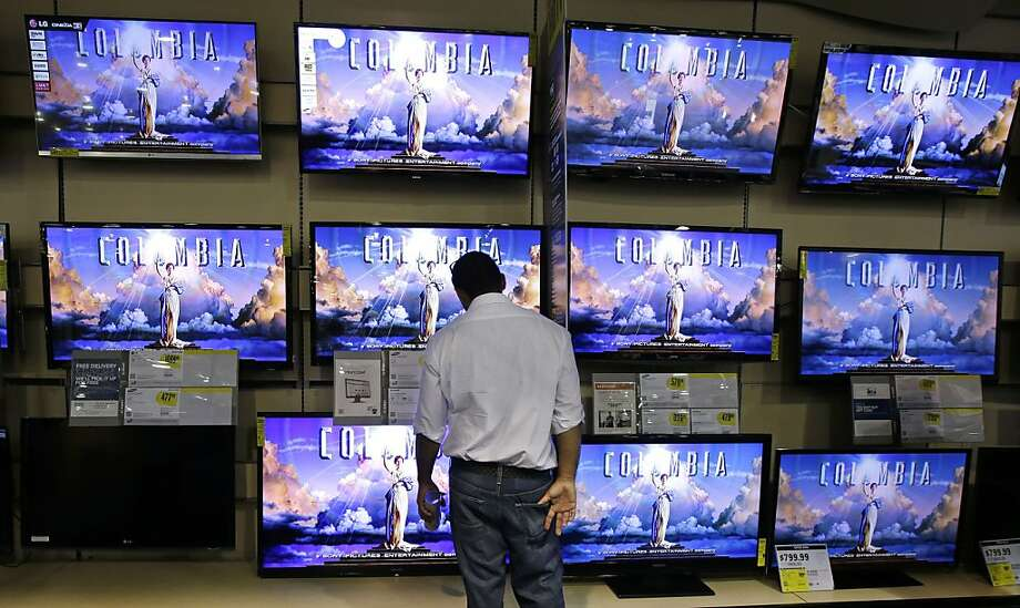 A shopper looks at televisions at a Best Buy store, Friday, Nov. 23, 2012, in Franklin, Tenn., after the store opened at midnight. Black Friday, the day when retailers traditionally turn a profit for the year, got a jump start this year as many stores opened just as families were finishing up Thanksgiving dinner. (AP Photo/Mark Humphrey) Photo: Mark Humphrey, Associated Press
