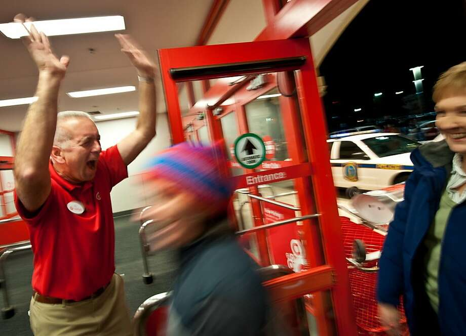"""Welcome to my store.  Boooo Walmart- Yaaayyyy Target!"" yells Target's Manager Jay Fitzgerald as shoppers flood his Harbison store in Columbia, South Carolina, Thursday, November 22, 2012, to get the jump on Black Friday shopping. Fitzgerald, who recently retired from the Air Force after 27 years of service, took over the Harbison Target just three and a half weeks ago. (C Michael Bergen/The State/MCT) Photo: C Michael Bergen, McClatchy-Tribune News Service"