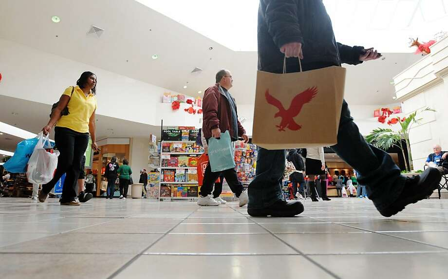 People walk through the River Ridge Mall in Lynchburg, Va. on Black Friday, Nov. 23, 2012 in search of holiday sales. (AP Photo/The News & Advance, Sam O'Keefe) Photo: Sam O'Keefe, Associated Press