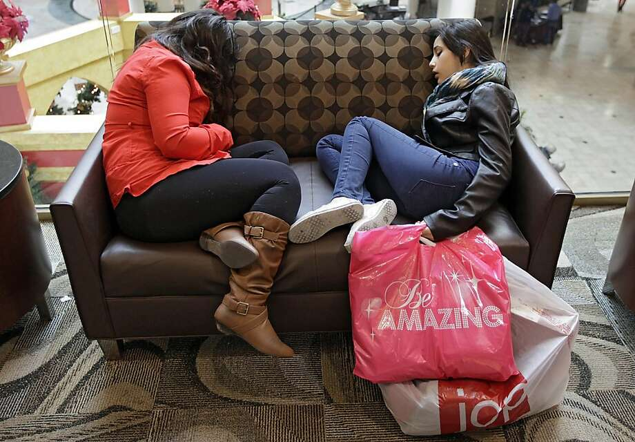 Cousins Maricruz Munoz, 15, left, and Monica Murillo, 15, sleep on a break from Black Friday shopping at Woodland Hills Mall Friday, Nov. 23, 2012 in Tulsa, Okla. (AP Photo/Tulsa World. Mike Simons) Photo: Mike Simons, Associated Press