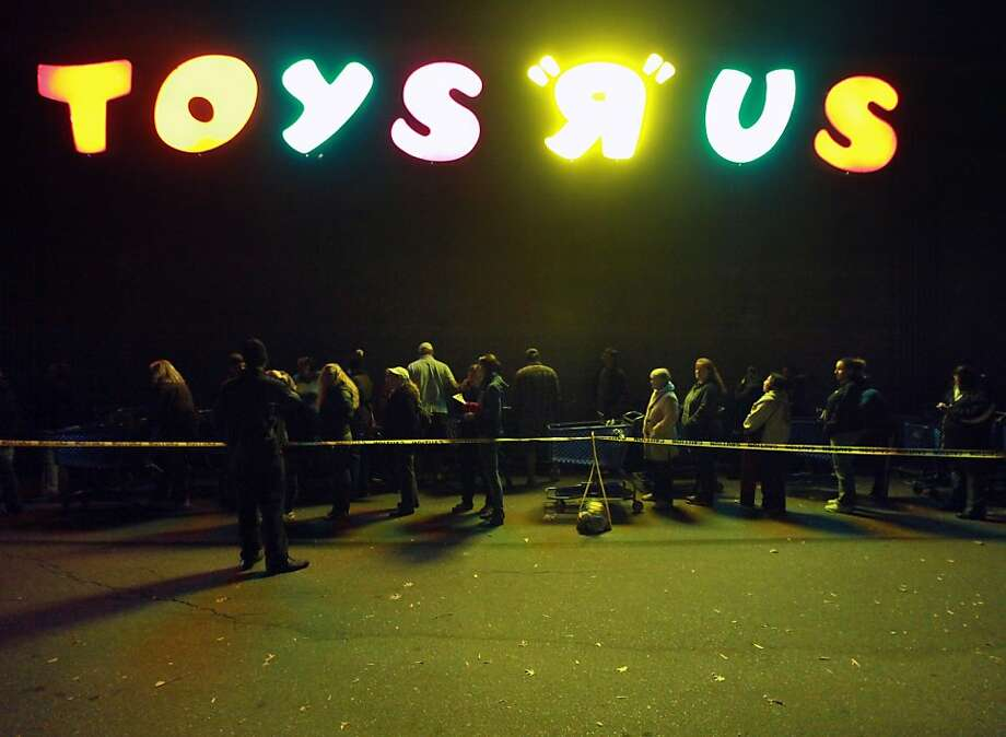 "A line forms outside of Toys ""R"" Us formed before its opening at 8 p.m. as shoppers took advantage of the sales and deals in the earlier shopping period for the typical ""Black Friday"" event on Thursday evening, Nov. 22, 2012 in Chico, Calif. (AP Photo/Jason Halley, Chico Enterprise-Record) Photo: Jason Halley, Associated Press"