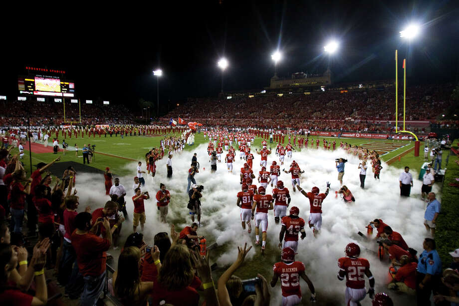 UH Cougars storm into the sold out stadium to play Texas Tech  in college football action at Robertston Stadium Saturday, Sept. 26, 2009, in Houston. Photo: Smiley N. Pool, Houston Chronicle / Houston Chronicle